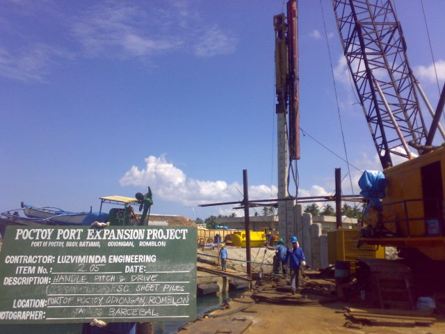 PSC Pile Driving using Hydraulic Impact Hammer on Barge Crane